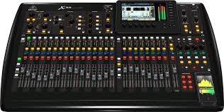 Front facing photo of a Behringer X32 with all front IO visible.